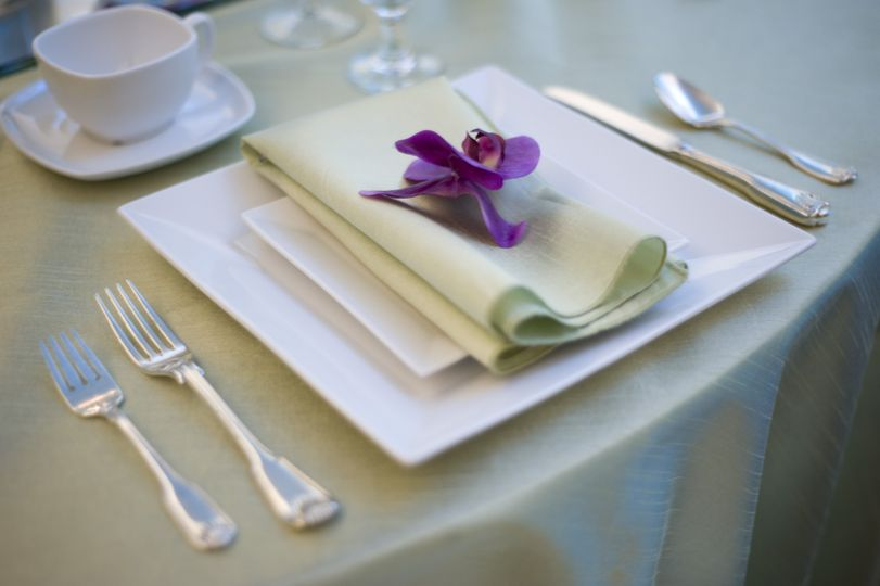Green table napkin with flower