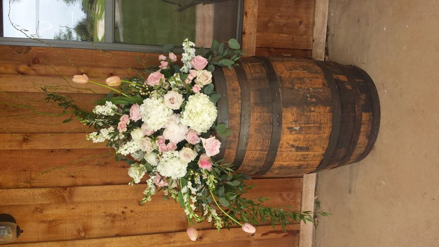 Wine Barrels and flowers ...can't go wrong with this combo