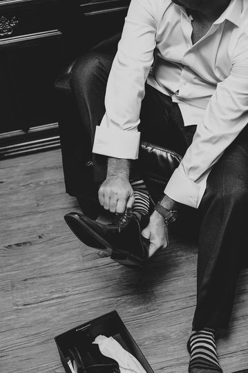 Groom wearing his shoes