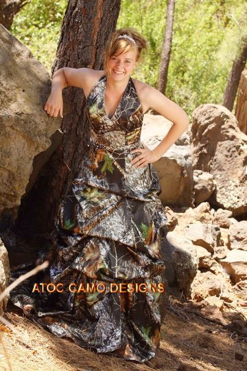 HOLLY is a halter styled gown with pick ups on the skirt and hand beading on the bodice at at the...
