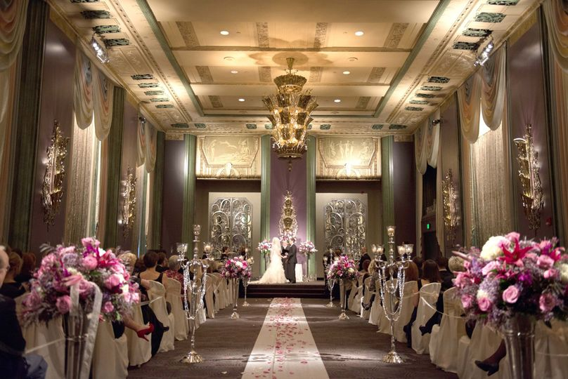 Wedding ceremony with pink flowers
