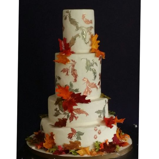 Hand painted fall wedding cake with sugar leaves