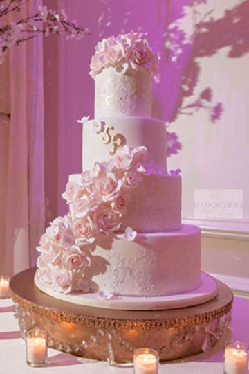 Damask side design with half-cascade of sugar roses. Venue is rockleigh country club. Photography by...