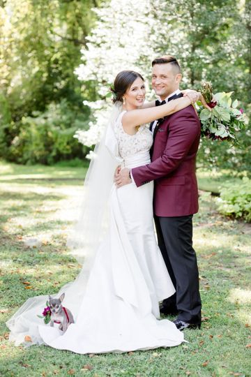 Newlyweds pose outside
