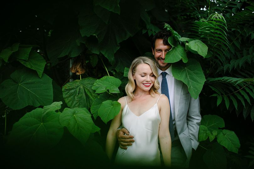 Newlyweds surrounded with plants