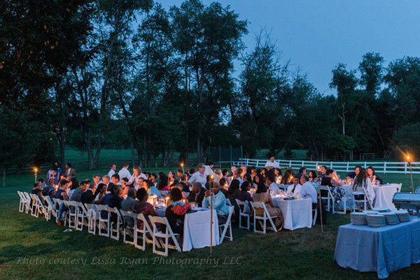 Twilight provided a magnificent backdrop at this outdoor wedding reception in the couple's backyard....