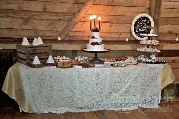 """Love is sweet!"" proclaims the sign on the dessert table at this Rocklands Farm wedding. (Photo by..."