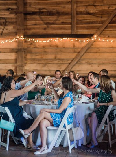 The walls of the weathered barn at Rocklands Farm are a great backdrop for a toast to the newlyweds....