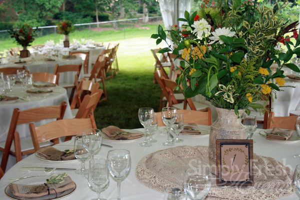 A white tents turns the family's backyard into an ideal wedding venue with touches of burlap and...