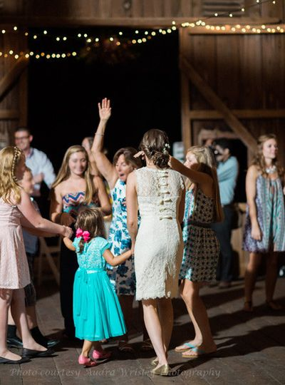 Guests dance the night away under the fairy lights strung in the barn at Rocklands Farm. (Courtesy...