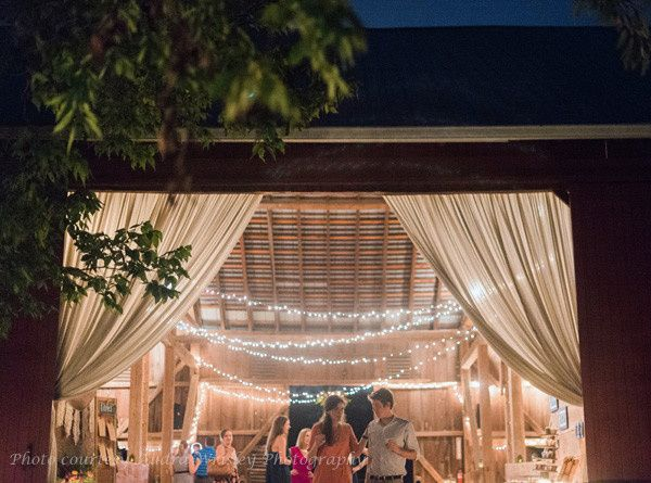 The entrance to the barn at Rocklands Farm is transformed in the twilight by the addition of filmy...