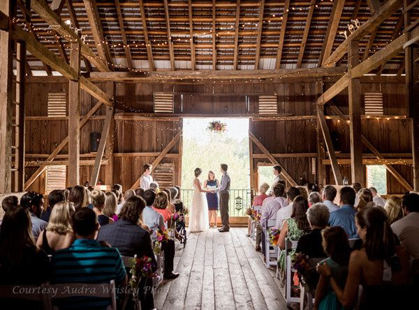 The wedding ceremony itself is framed in the doorway of the Rocklands Farm barn. (Courtesy Audra...