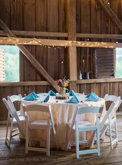 Teal blue and simple flowers: a perfect combination in the barn at Rocklands Farm. (Courtesy Audra...