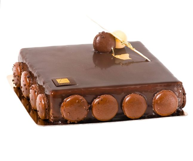 3 Chocolate Layers  For chocolate lovers! Thick layers of dark, milk and ivory chocolate on a...