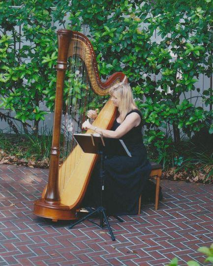 Harpist Victoria Lynn Schultz performing for a Garden Wedding Ceremony
