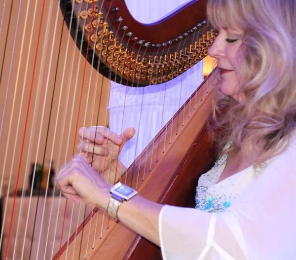 Harpist Victoria Lynn Schultz performing for a convention event at the Marriott World Center