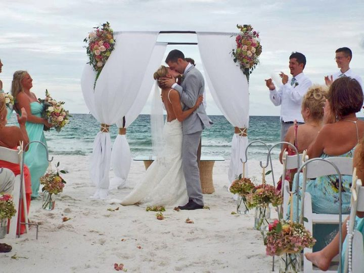 Beach wedding kiss