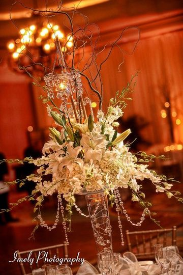 Elevated guest table arrangement of white orchids, lilies and hydrangea at the Ritz Carlton Sarasota