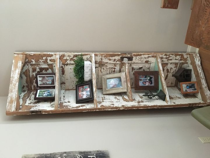 This beautiful corner shelf is an excellent way to show off pictures of those who are at your...