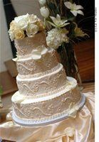 All white wedding cake with flowers on top