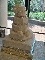 Tall white cake with silver decorations