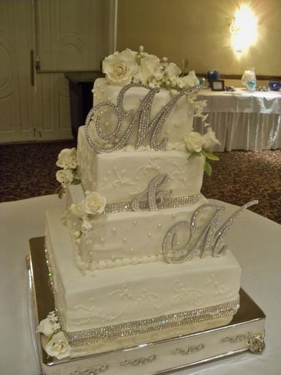 Rectangular wedding cake with flowers on top