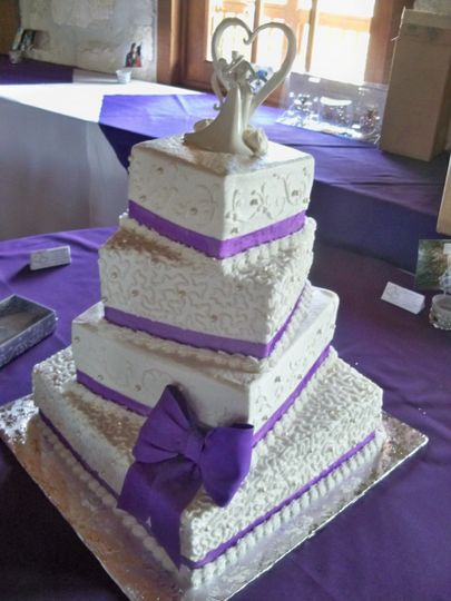 Wedding cake with purple ribbons