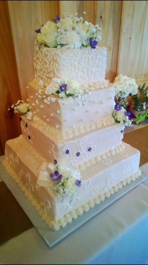 White wedding cake with little flowers