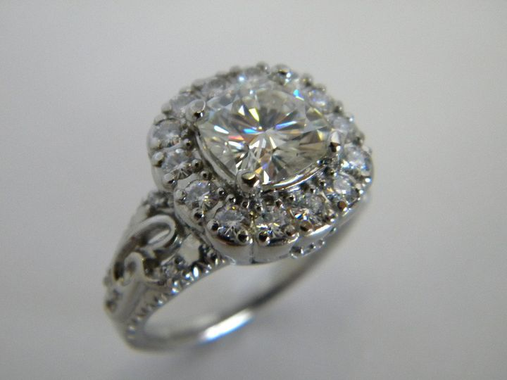 Custom diamond engagement ring with initials.