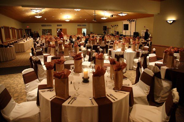 VOA lodge in West Chester.  Ivory linen and chair covers with chocolate brown napkins and sashes.