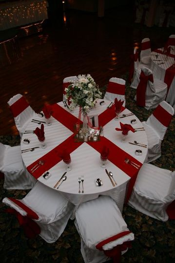 White imperial stripe linens and chair covers, cherry red sashes, napkins, and table runners....