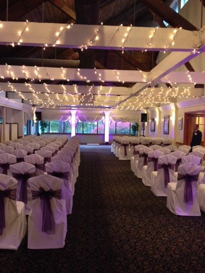 ceremony with purple uplighting