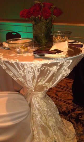 Ivory Ribbon Taffeta Cocktail Table with Silver Beaded Chargers and Ivory Lamour Satin napkins