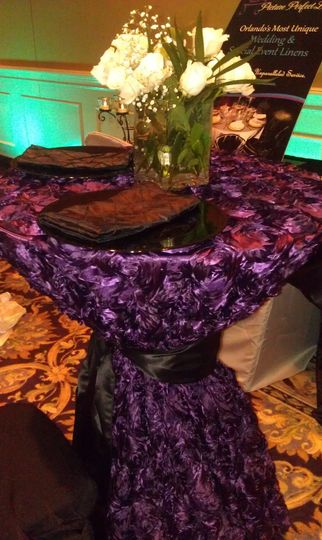 Plum Rosette Satin Cocktail Table with Black Lamour Satin Sash & Napkins and Black Beaded Chargers