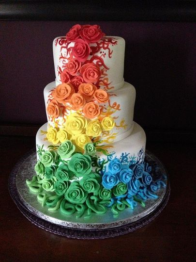 Fondant covered cake with hand-sculpted roses - $4.25 per serving