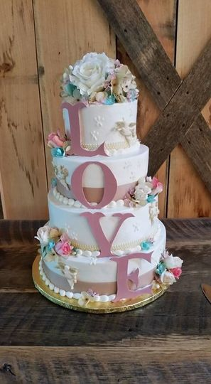 Buttercream frosted  cake with fondant and white chocolate accents - $2.50 per serving ($2.75 for 5+...