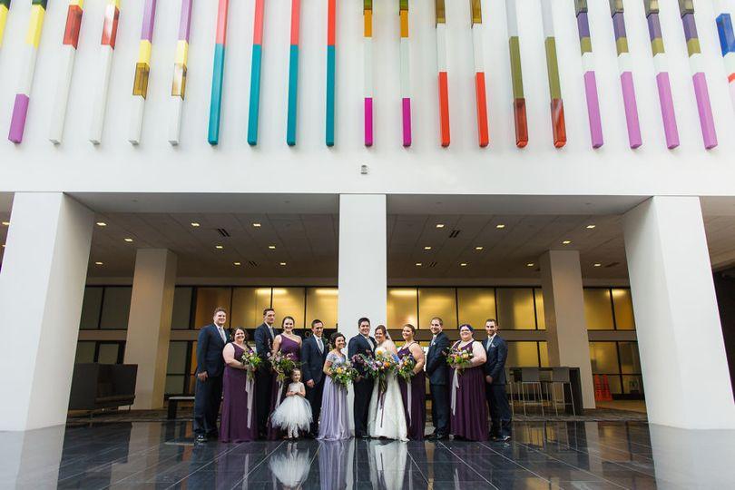 Newlyweds and wedding attendants