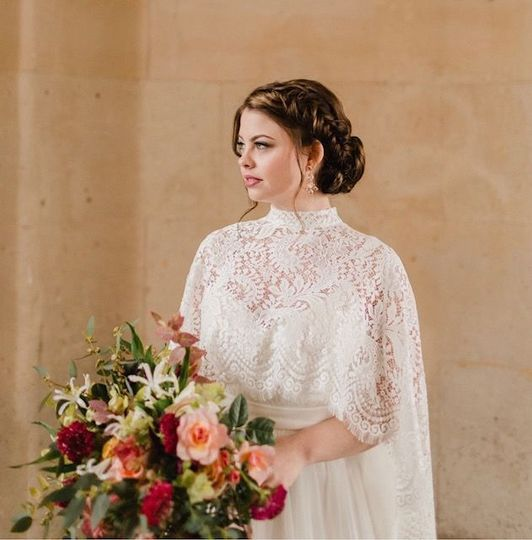 Fishtail braid updo for this  featured destination wedding in Paris, France, Photo by Courtney...