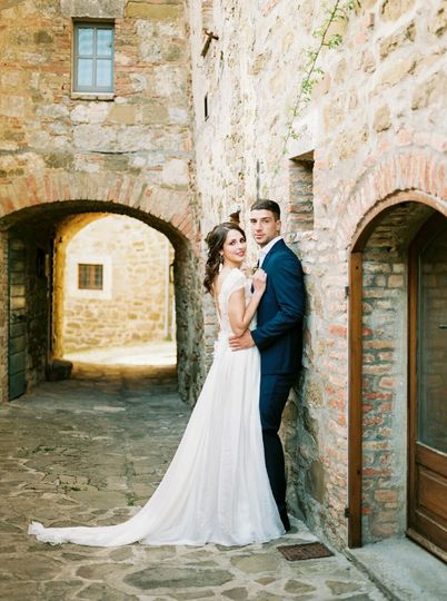 Tuscany bride, with a low updo.Published and Featured on the Wedding Sparrow. Photo by Justina...