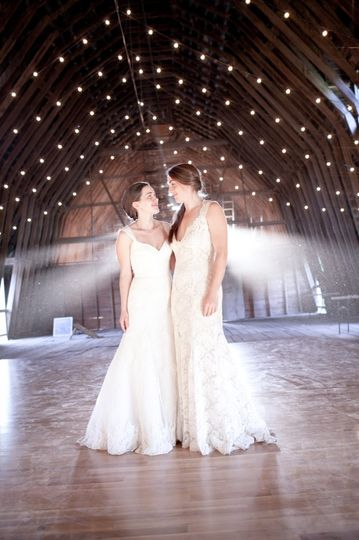 Two gorgeous brides in a barn wedding