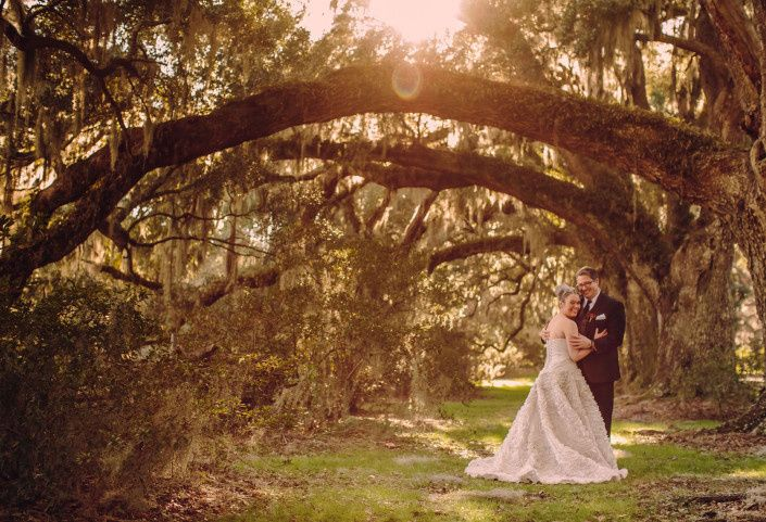 Newlywed couple in the setting sunshine
