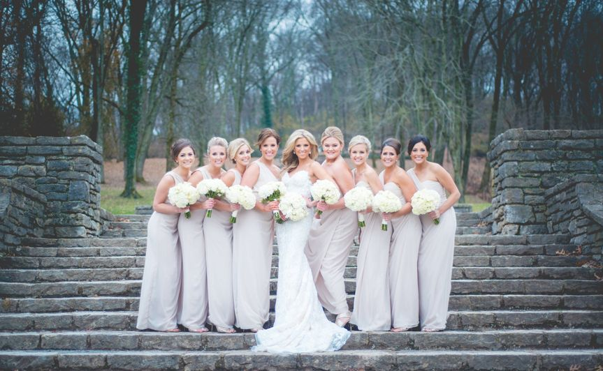A smiling bridal party