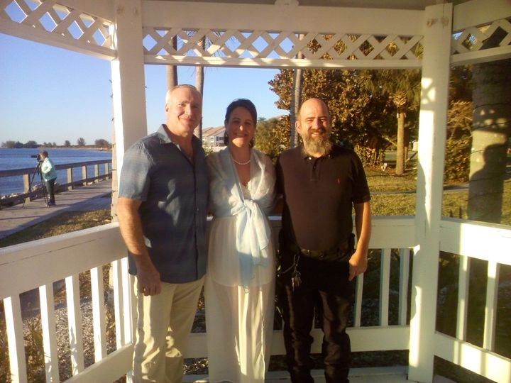 Reverend and the newlyweds at the gazebo