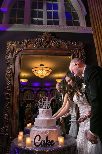 cutting the wedding cake at the ballroom at park lane