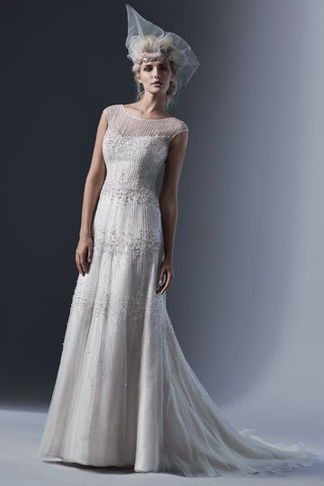Style Easton 		Delicate lines of opalescent pearls and sequins trace the length of this tulle...