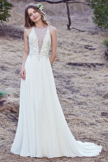 Maren		This sleeveless sheath features a bodice accented in Swarovski crystals and delicate...