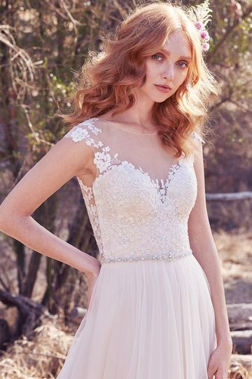 Sonja		Delicate lace appliqués float over the bodice, plunging sweetheart neckline, and illusion...