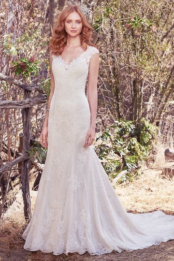 Tilda		This fit-and-flare features beaded lace appliqués atop allover lace. Lace appliqués adorn...