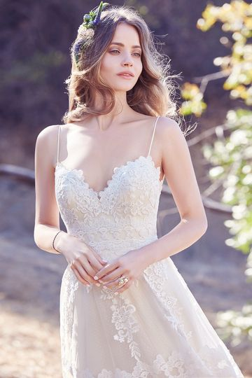 Emily		Chic and boho-inspired, this A-line features horizontal lace motifs, scattered lace...