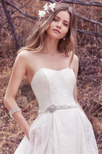 Dylan		This sweet and elegant ballgown features layers of Vega Organza. A strapless scoop...